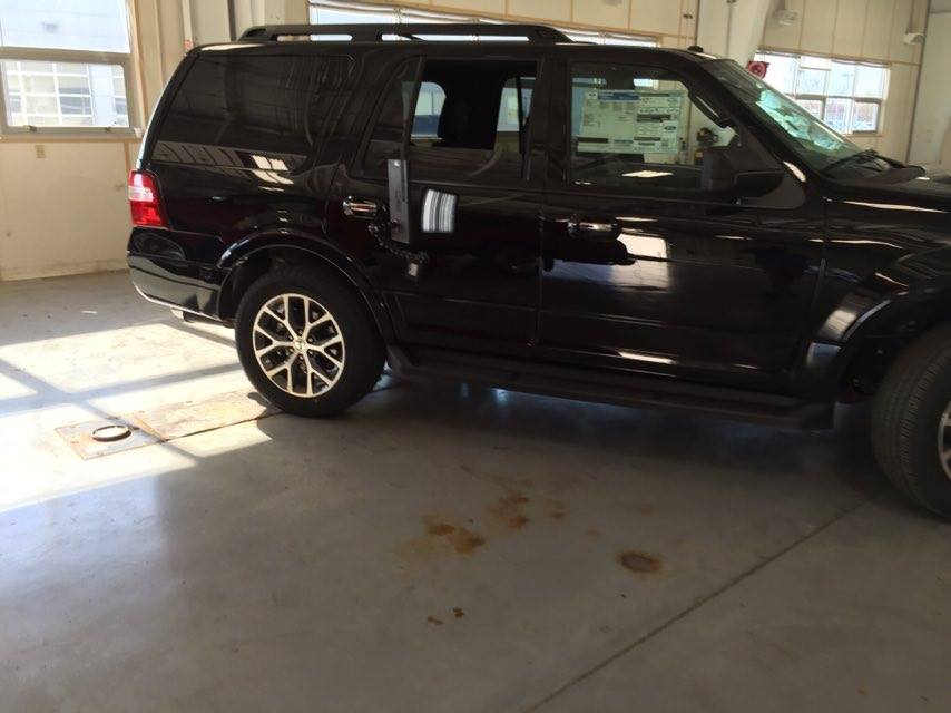 2016 Ford Explorer passenger rear door, Brand new vehicle dent repair performed by Michael Bocek with http://217dent.com and http://217dent.com