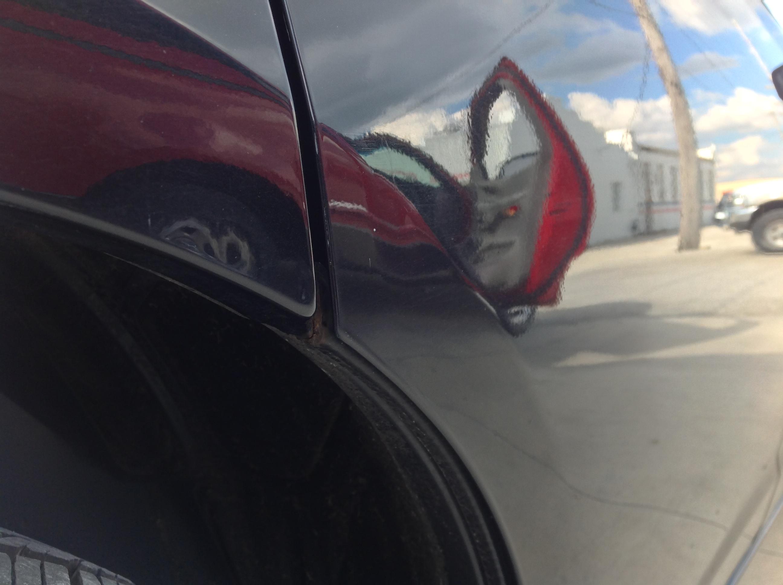 2011 Dodge Charger Passenger Rear Door Dent Removal, Springfield IL, Taylorville IL, Decatur IL, Mobile Dent Repair http://217dent.com