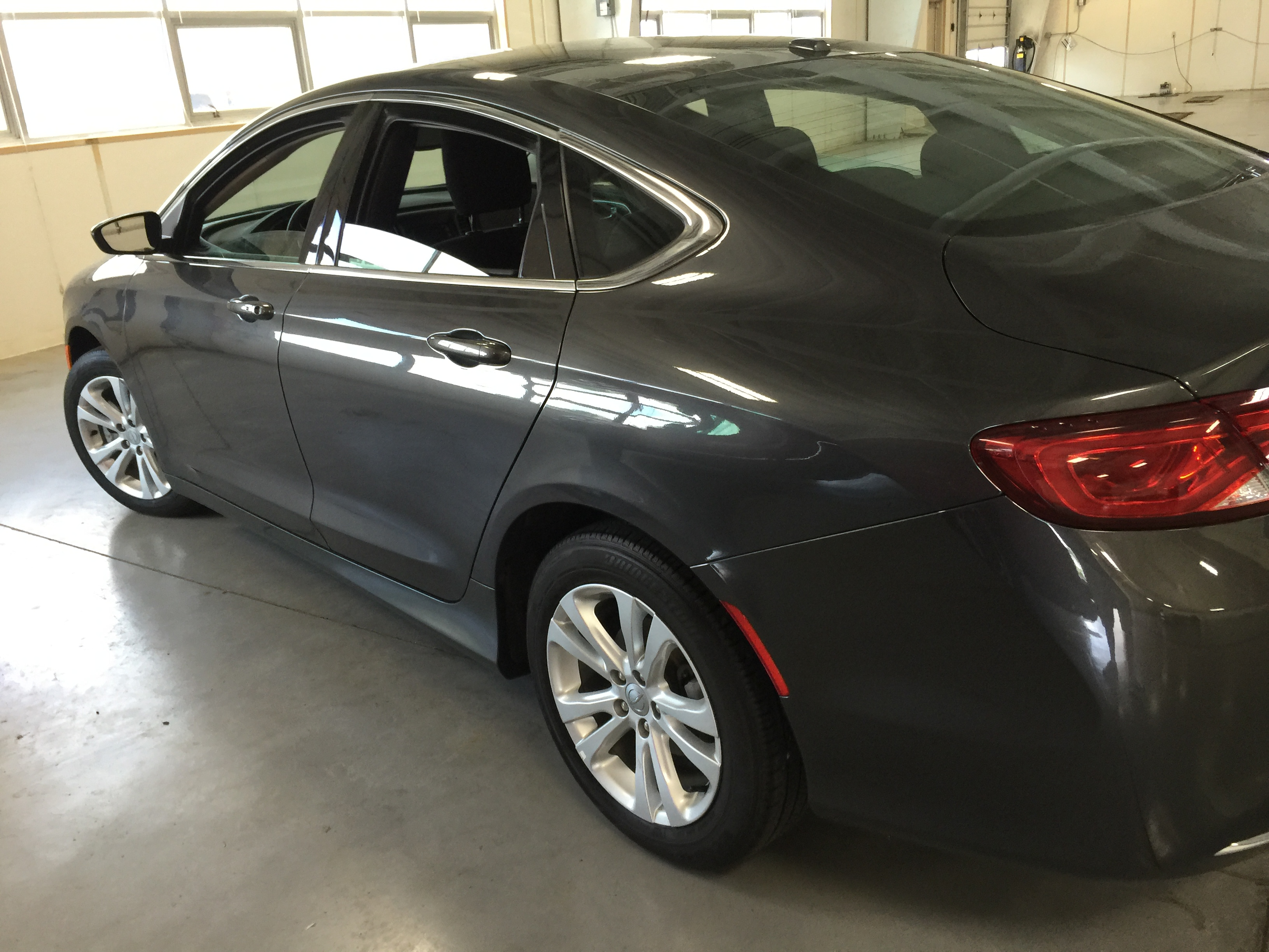 2015 Chrysler 200 Gray Metallic | Dent Removal On Passenger Side Rear Door. Work was done by Michael Bocek from 217dent.com. Go to http://217dent.com an estimate, or for more information about paintless dent removal