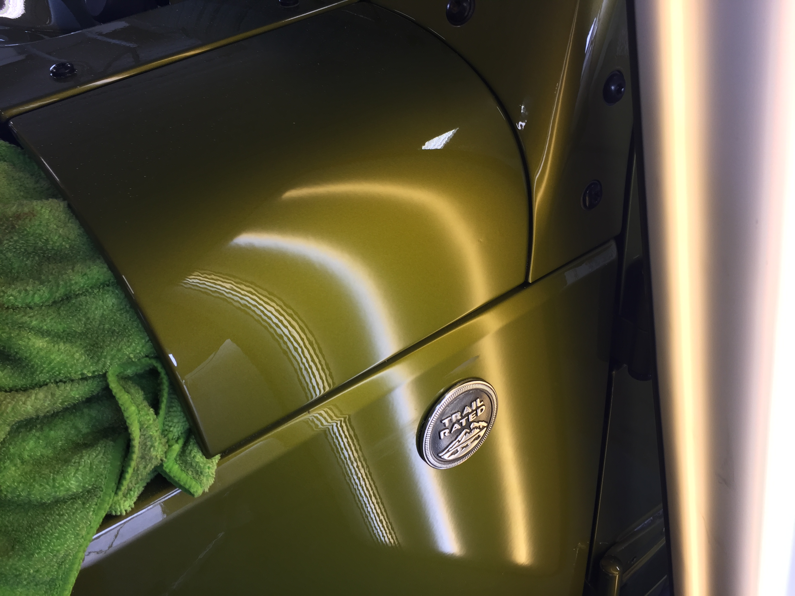 2007 Jeep Wrangler Rubicon Cowl Dent. Work was done by Michael Bocek from 217dent.com. Go to http://217dent.com an estimate, or for more information about paintless dent removal.