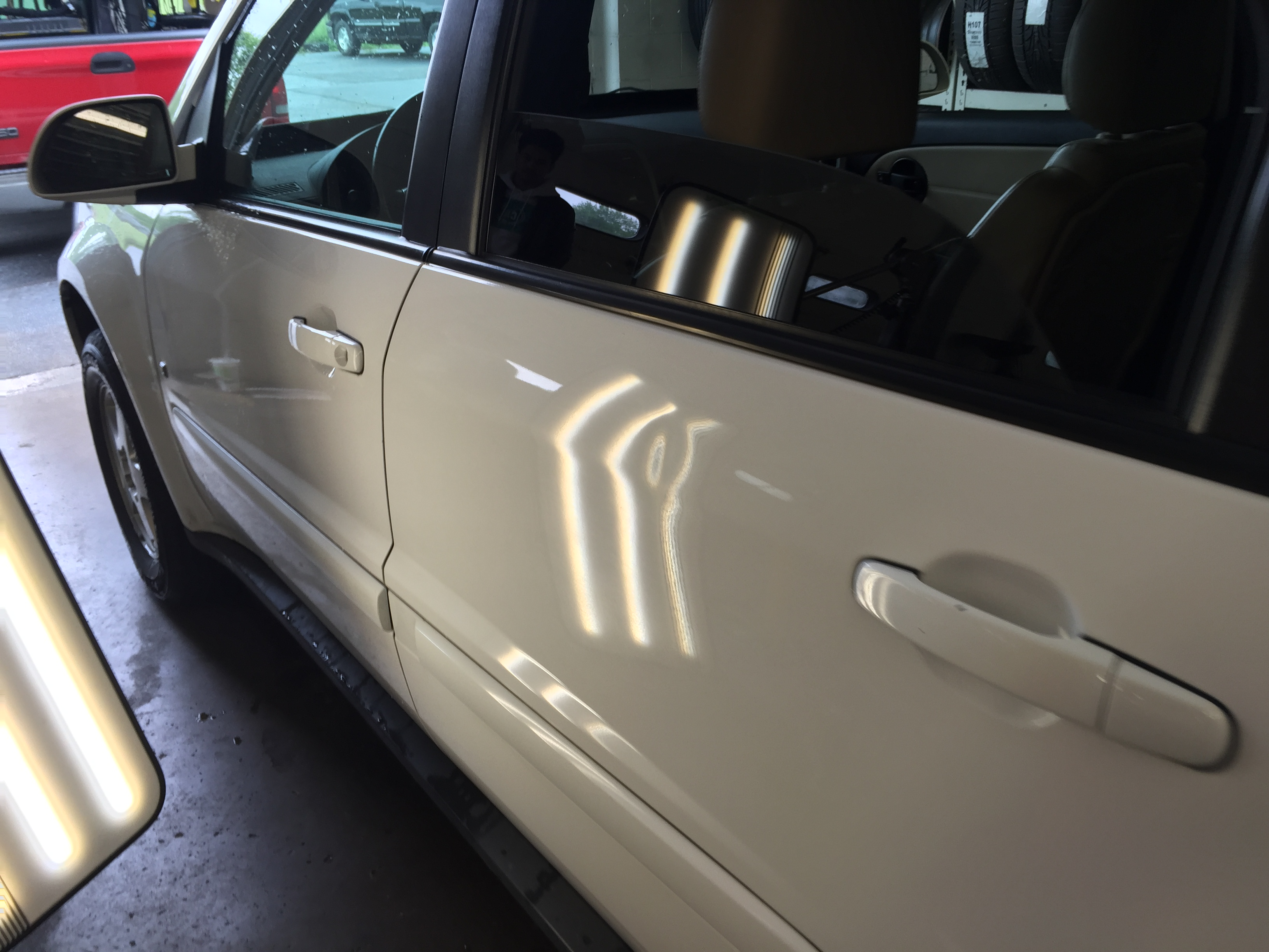 2009 White Torrent | Large Dent Drivers Rear Door. Work performed by Dent Expert Michael Bocek from 217dent.com. 217hail.com