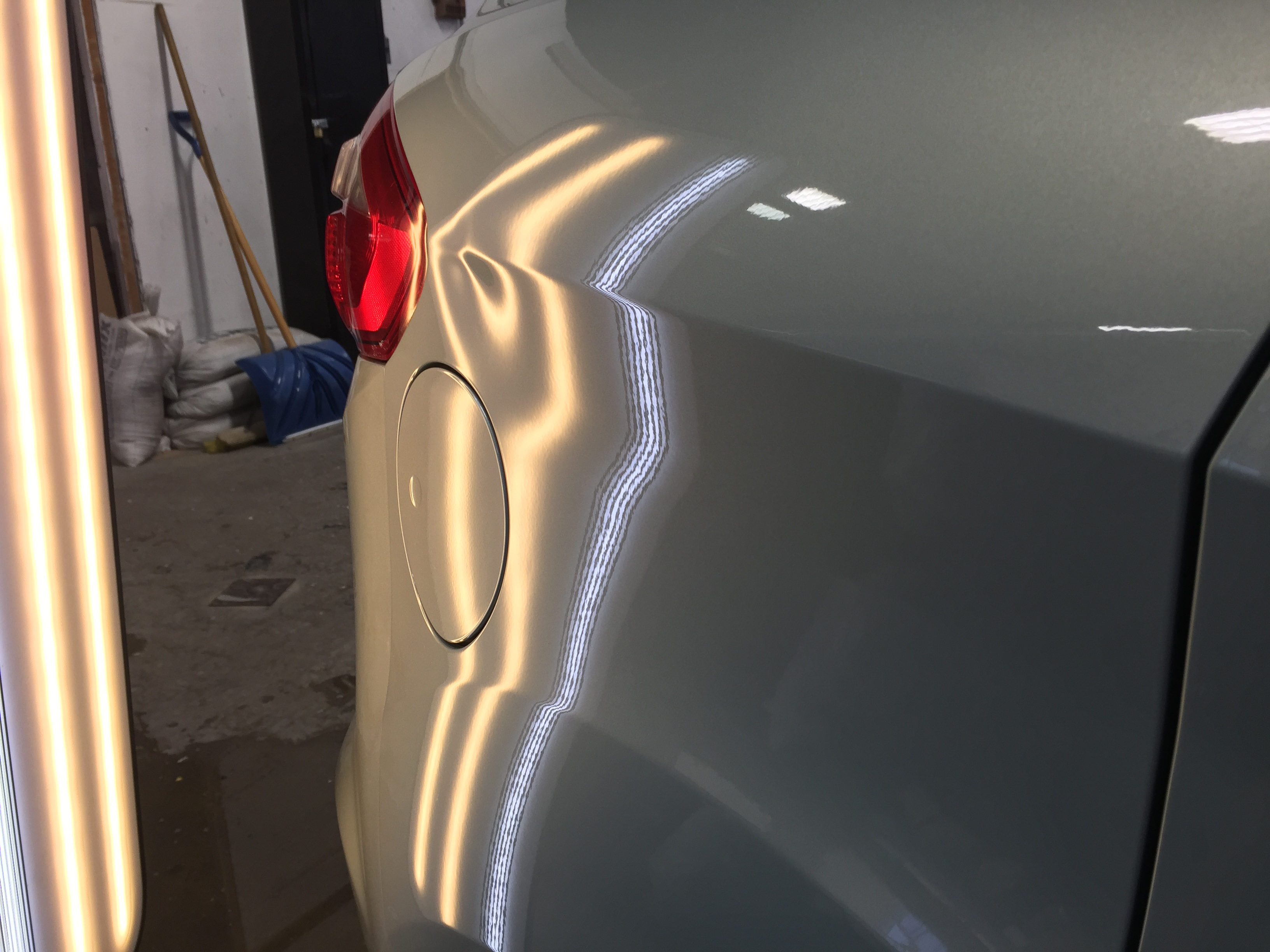 """2013 Ford C-Max Hybrid large dent in passenger rear quarter, access through tail light images of access to damaged area. Work done by """"dent expert"""" Michael Bocek from 217dent.com. For more information go to 217dent.com or 217hail.com"""