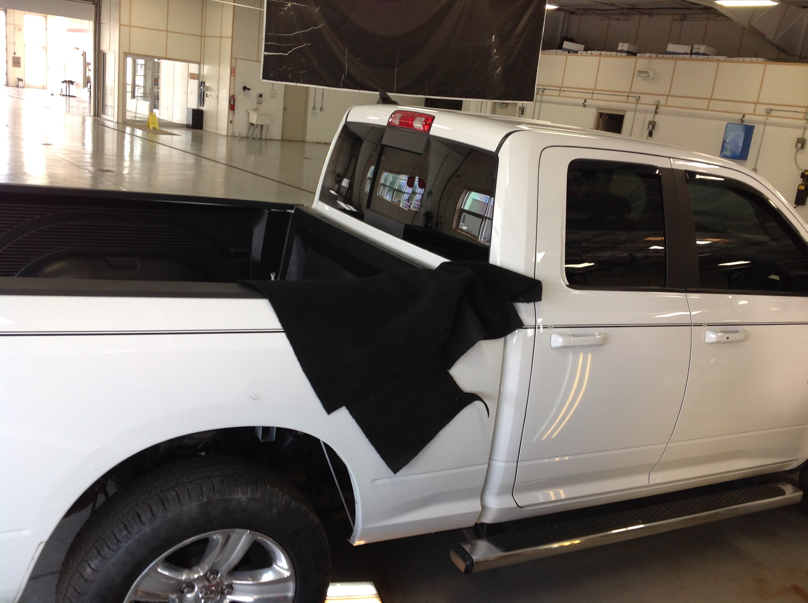 "2014 White Ram 1500. removal of rear inner wheel well. For Pdr access. For more information about ""paintless dent removal"" contact Michael Bocek at 217dent.com."
