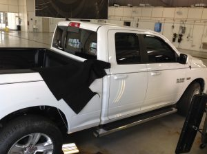 """2014 White Ram 1500. removal of rear inner wheel well. For Pdr access. For more information about """"paintless dent removal"""" contact Michael Bocek at 217dent.com."""