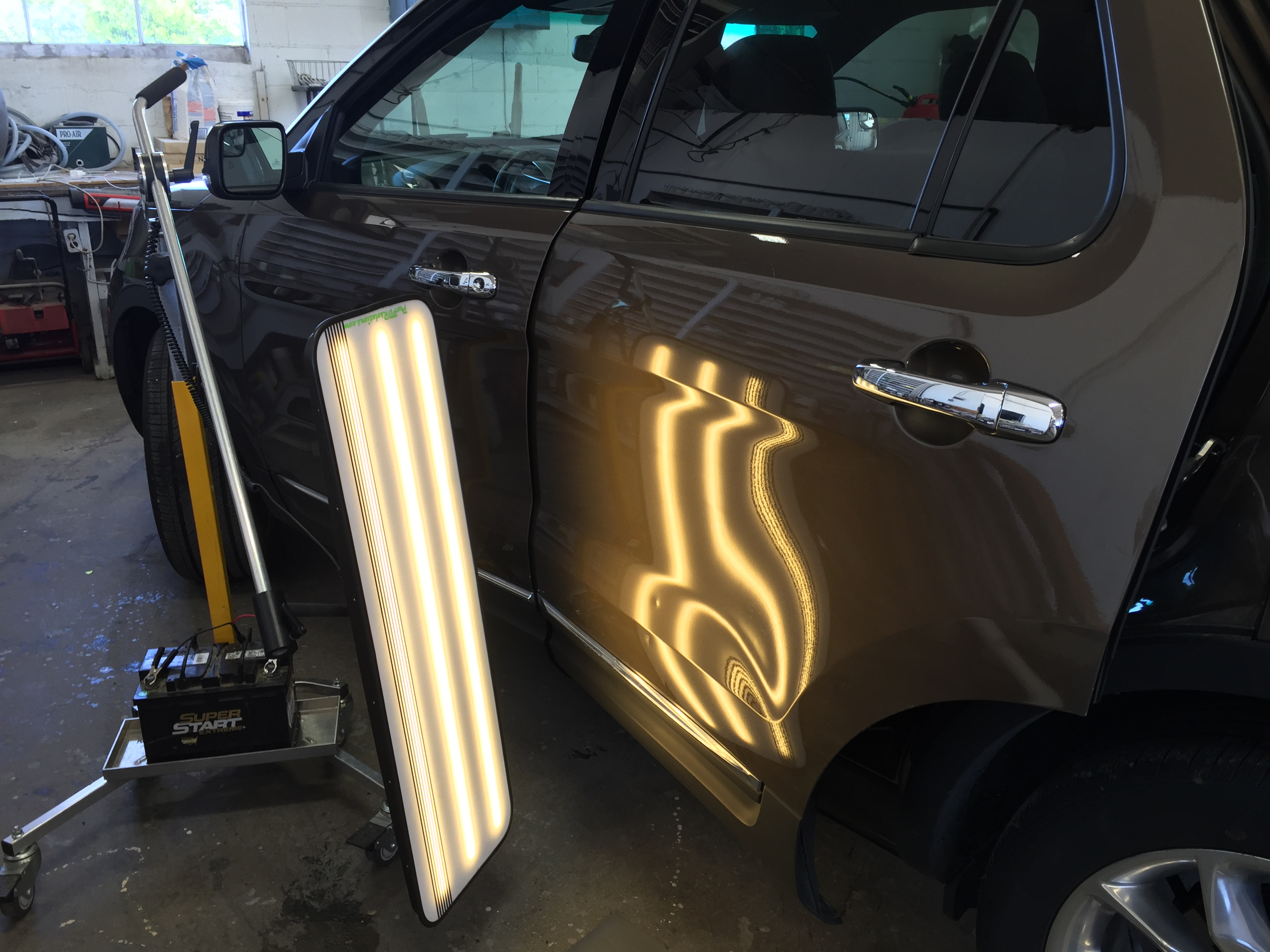 Mobile Dent Repair Springfield IL, 2015 Ford Explorer Drivers Side Rear Door, Dent Removal http://217dent.com
