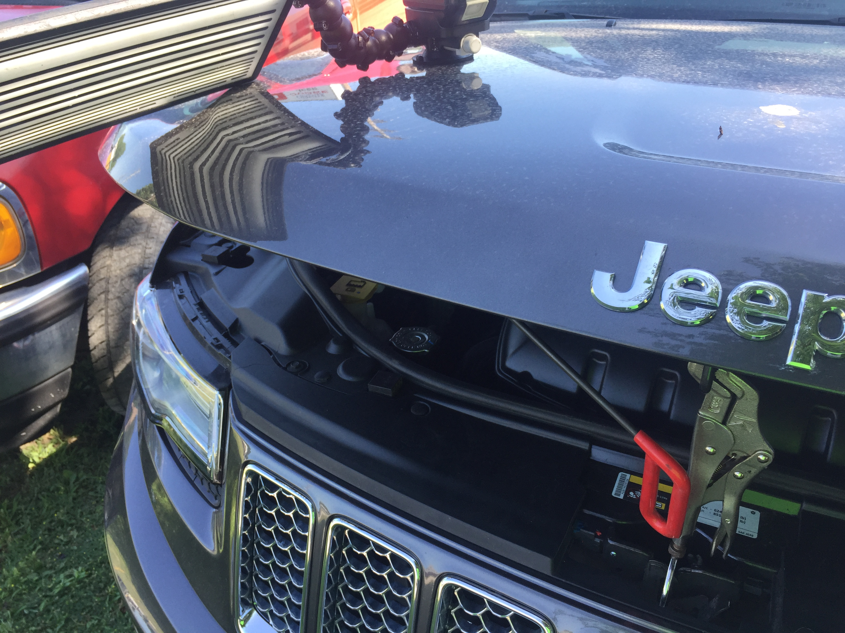 2014 Grand Cherokee Dent Repair on Hood, by Michael Bocek out of Springfield, IL http://217dent.com