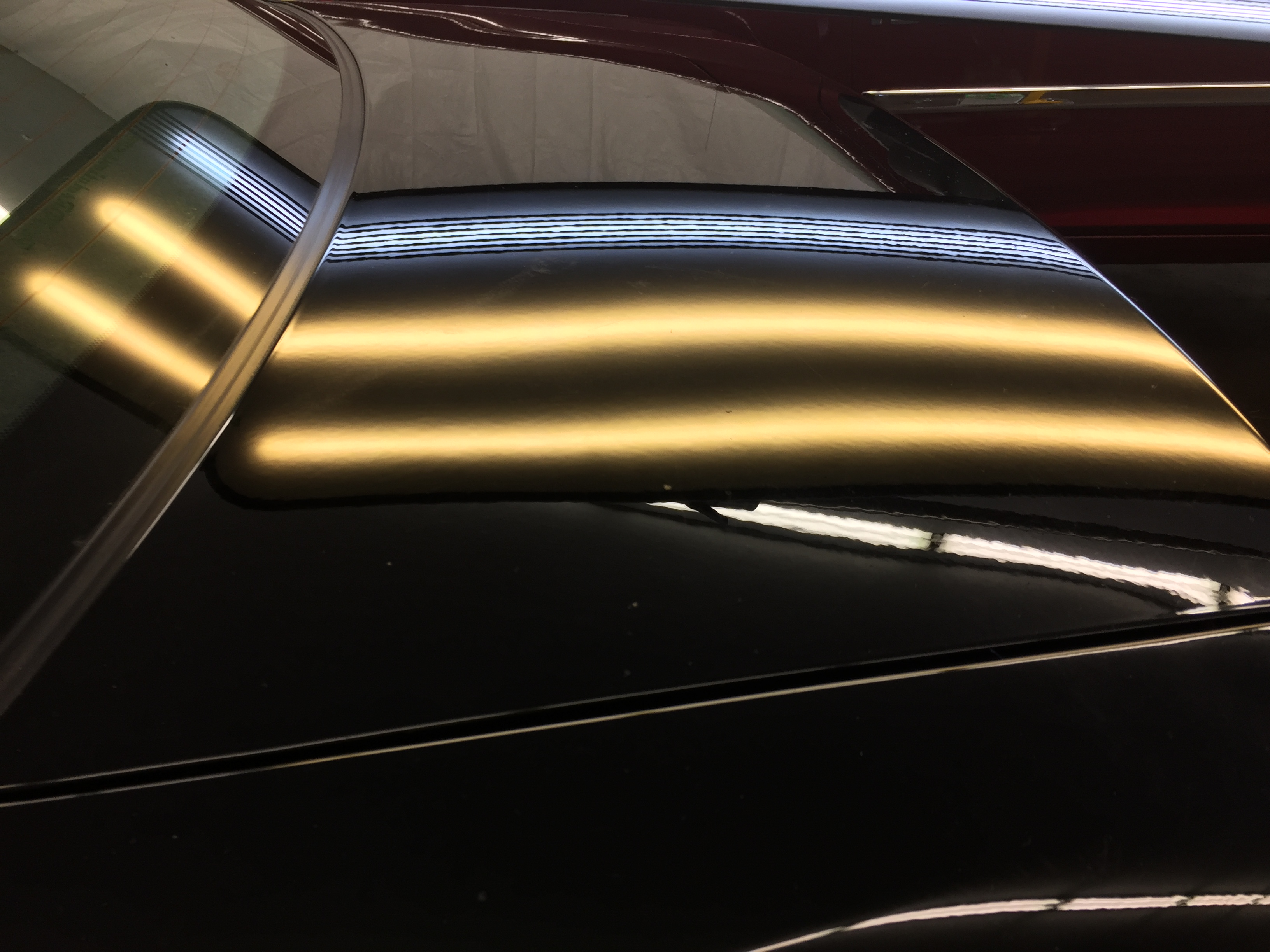 2015 Chevy Impala Hail damage removal on the trunk. Paintless Dent Repair, Paintless Dent Removal, Ding Removal, Springfield, IL, Michael Bocek. http://217dent.com