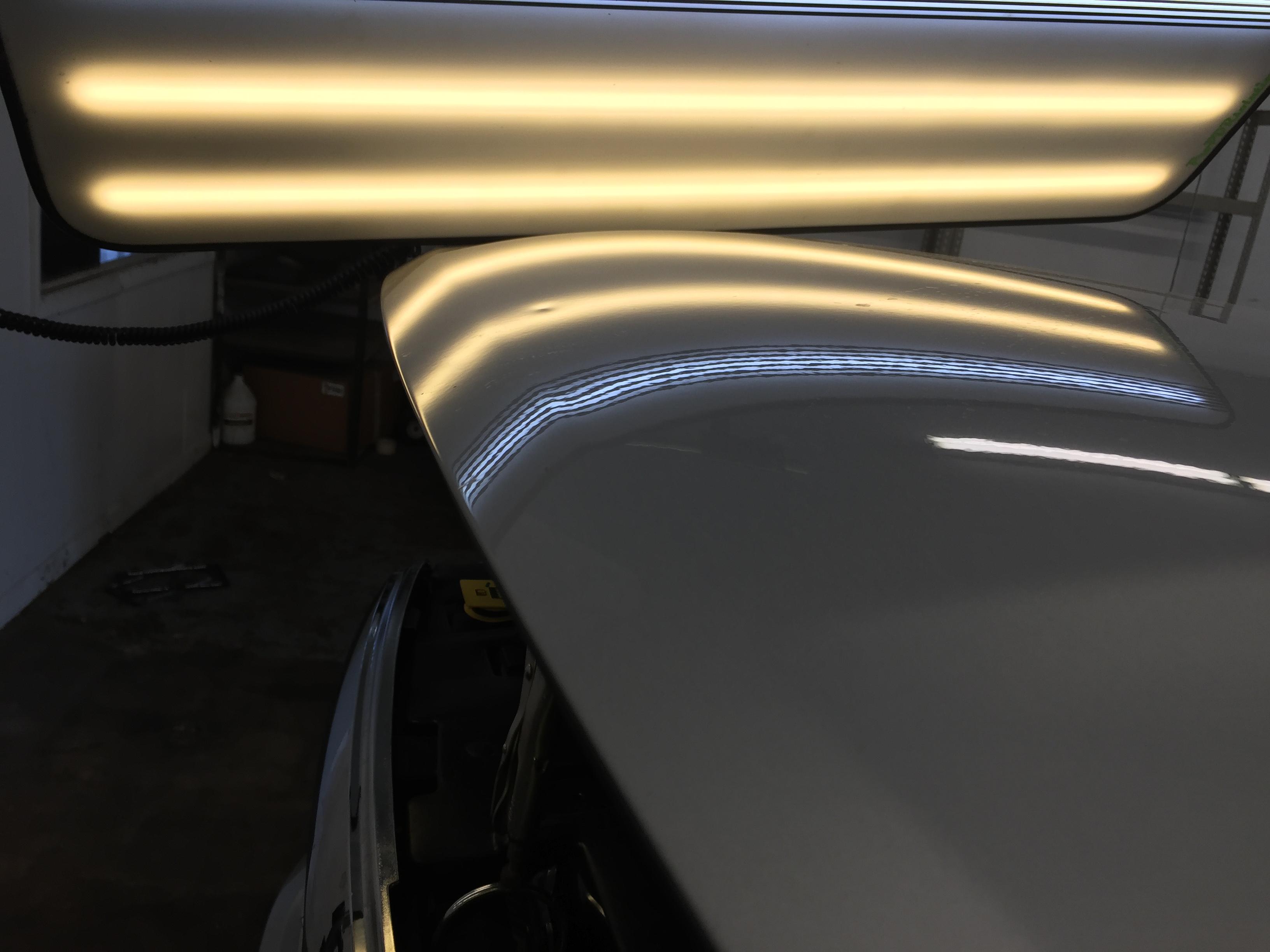 2015 Dodge Ram hail damage on hood, paintless dent repair, Springfield, IL. http://217dent.com by Michael Bocek