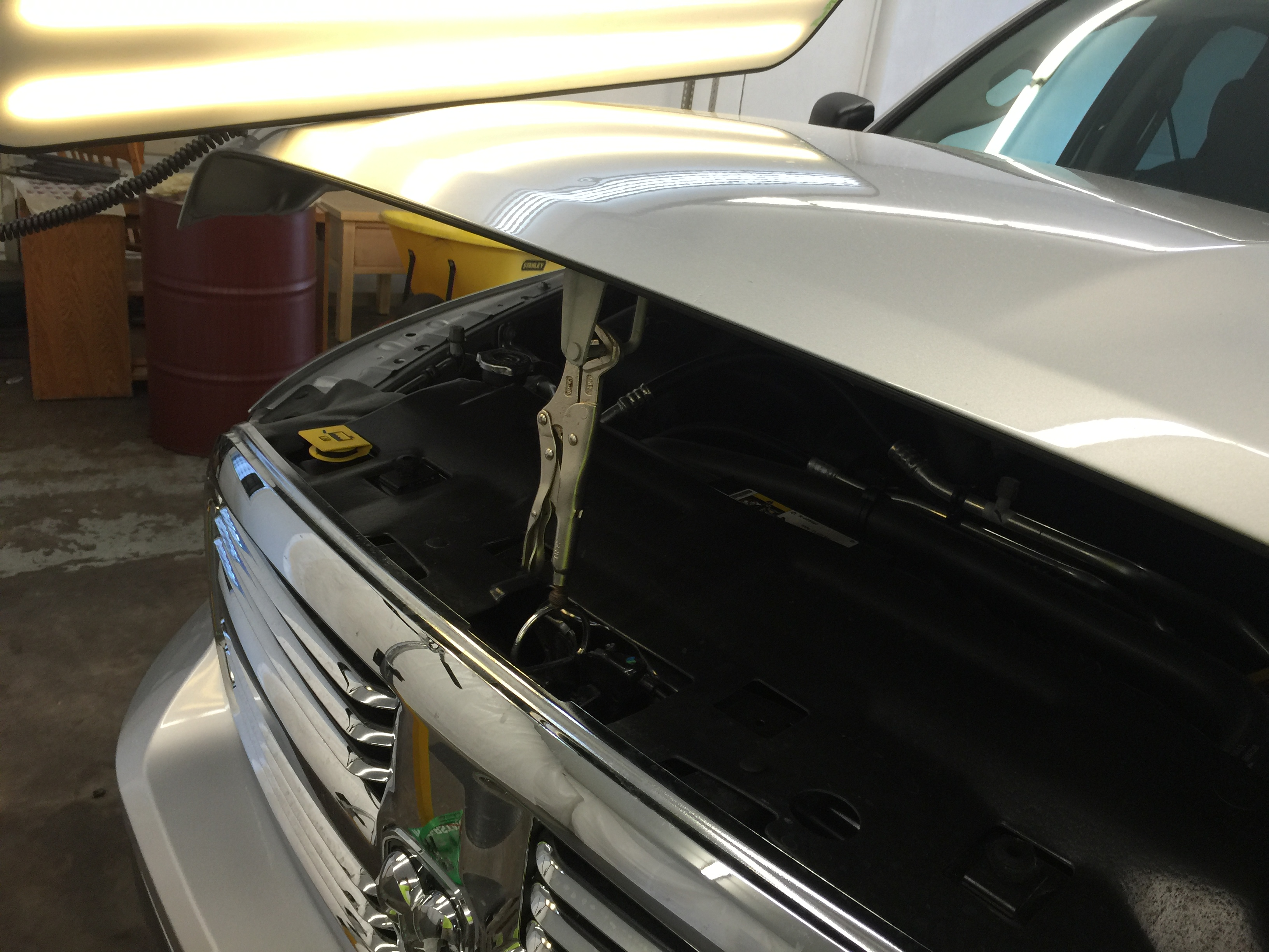 2015 Dodge Ram hail damage on hood, paintless dent repair, Springfield, IL. http://217dent.com by Michael Bocek