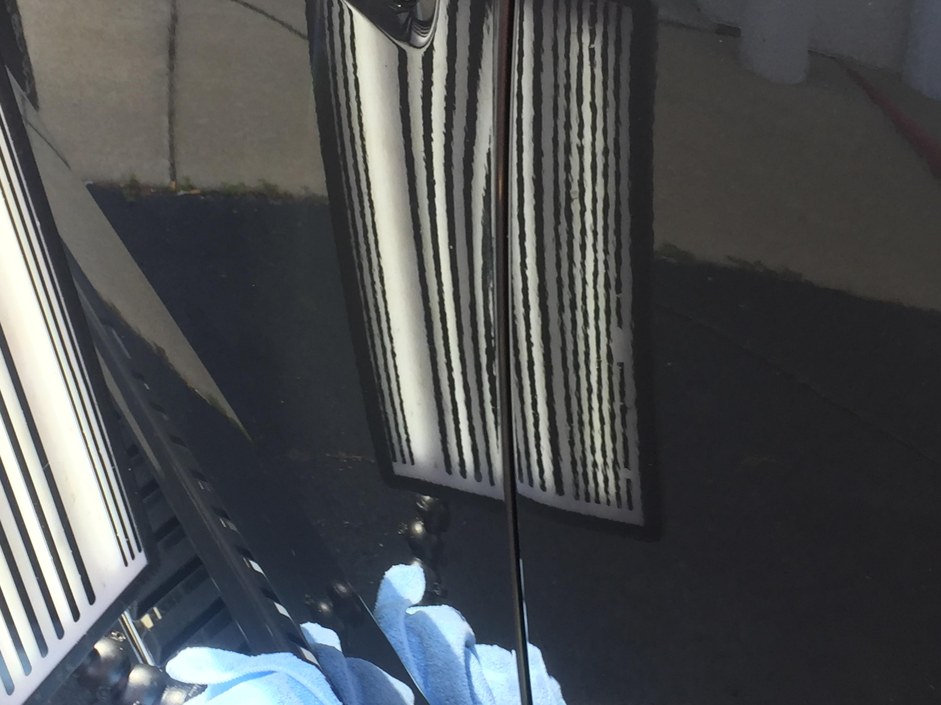 www.217dent.com 2015 Grey Aluminum Ford F-150 driver's side door dent removal near door-handle.