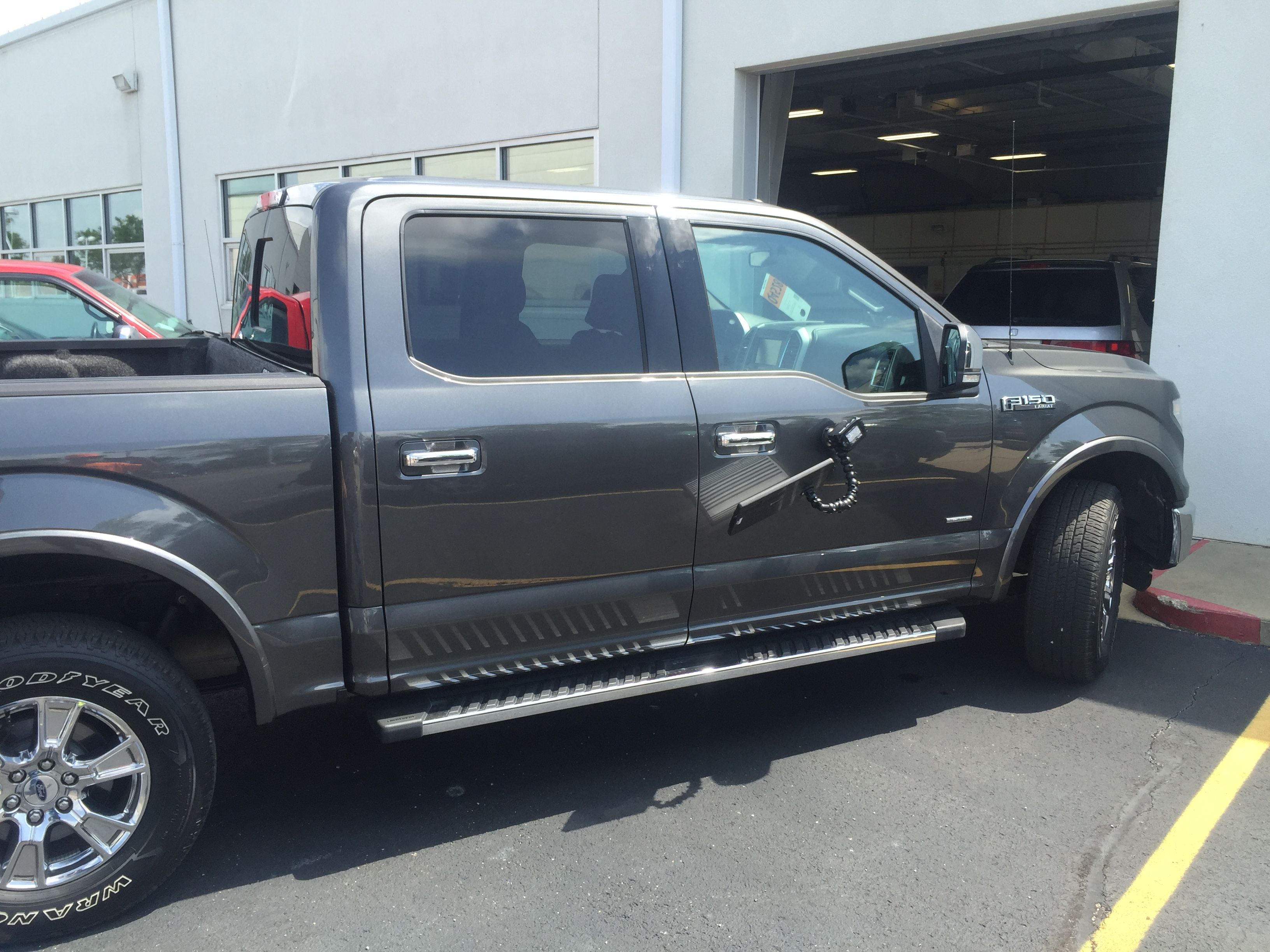 www.217dent.com 2015 Grey Aluminum Ford F-150 passenger side door dent removal near door-handle.