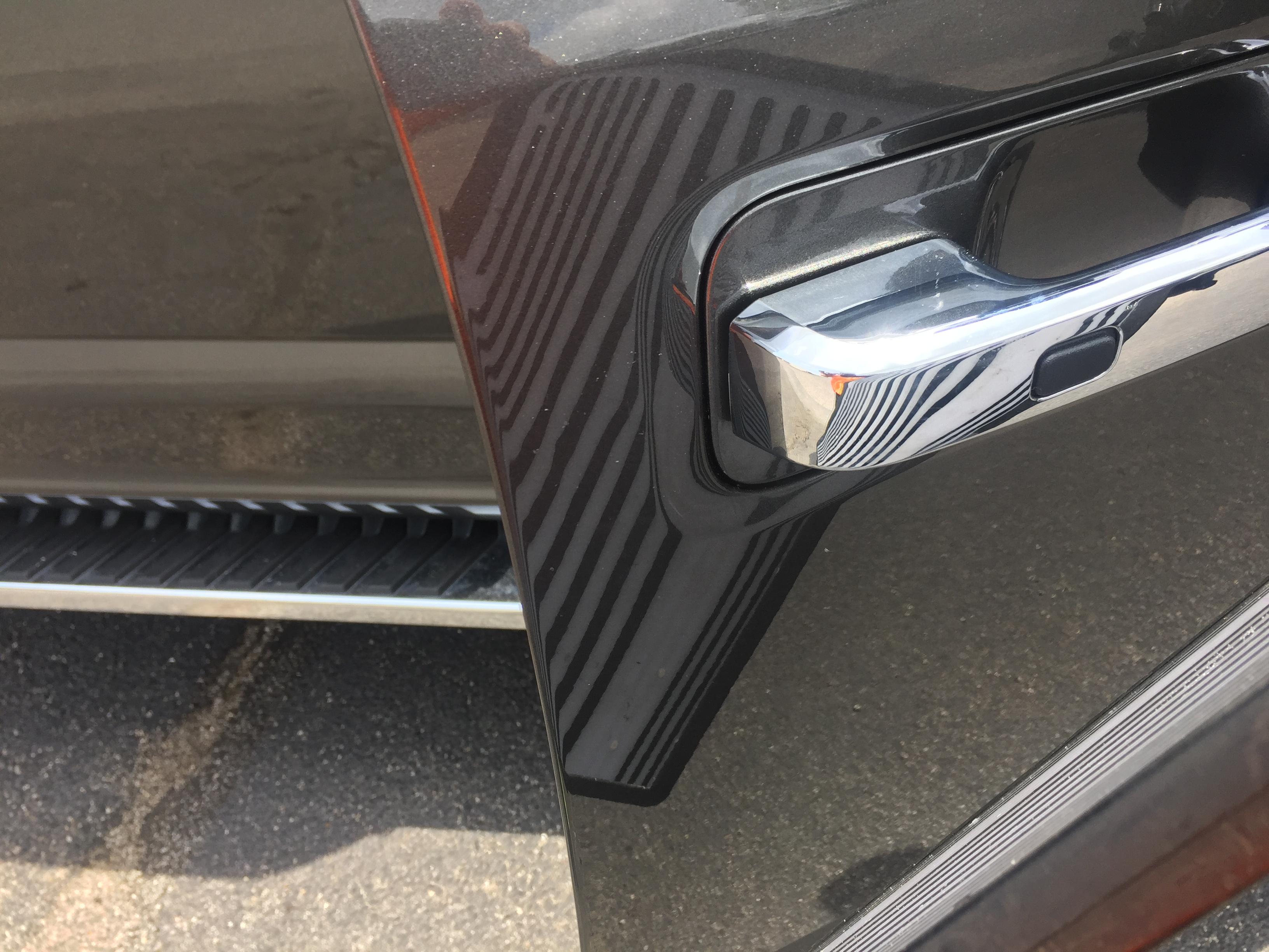 www.217dent.com 2015 Grey Aluminum Ford F-150 passenger side door dent removal near door-handle.
