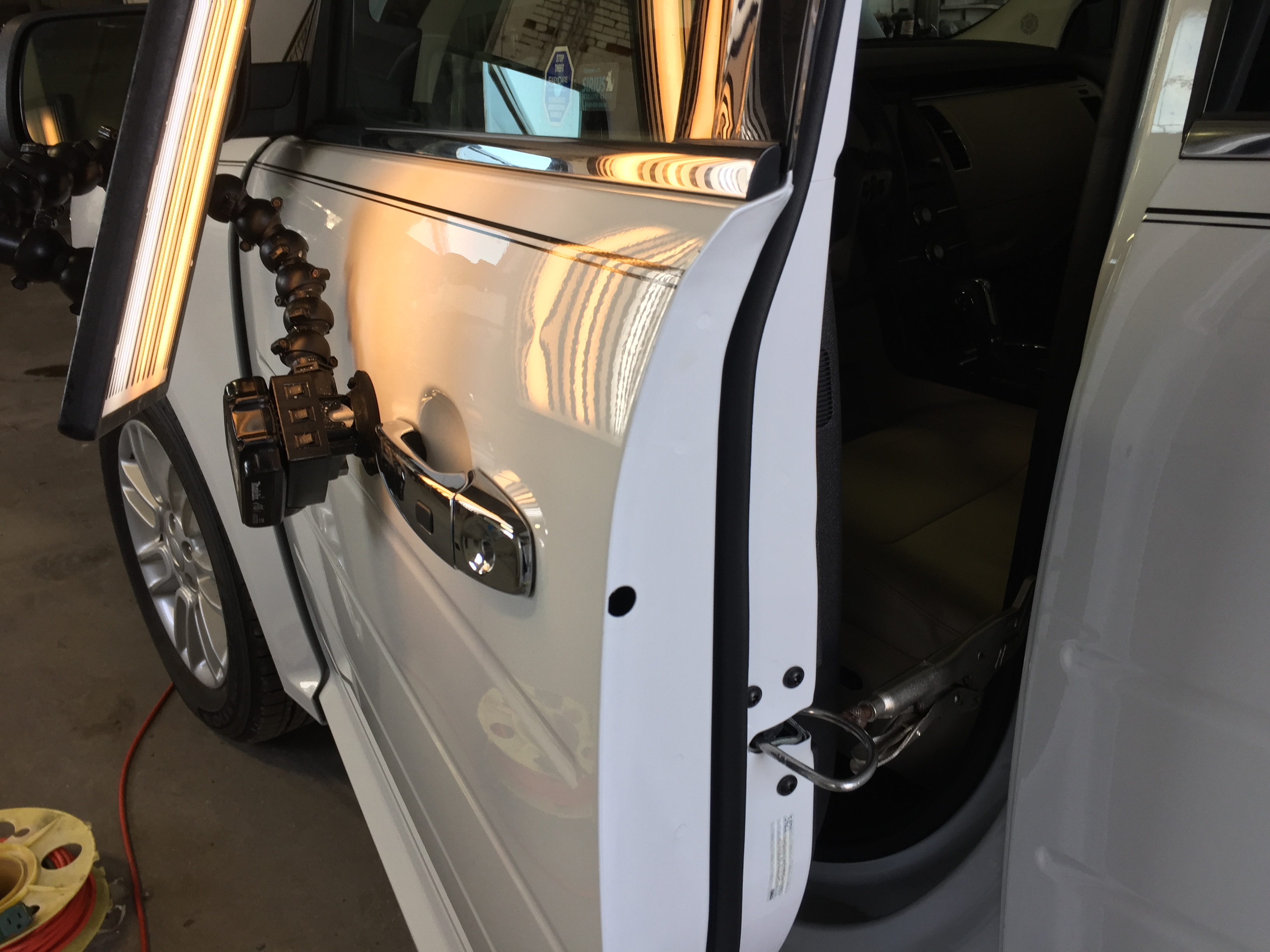2015 Ford Flex, Dent Removal in the drivers door, Image's of before during and after this dent removal process. Paintless Dent Repair, Springfield, IL, http://217dent.com
