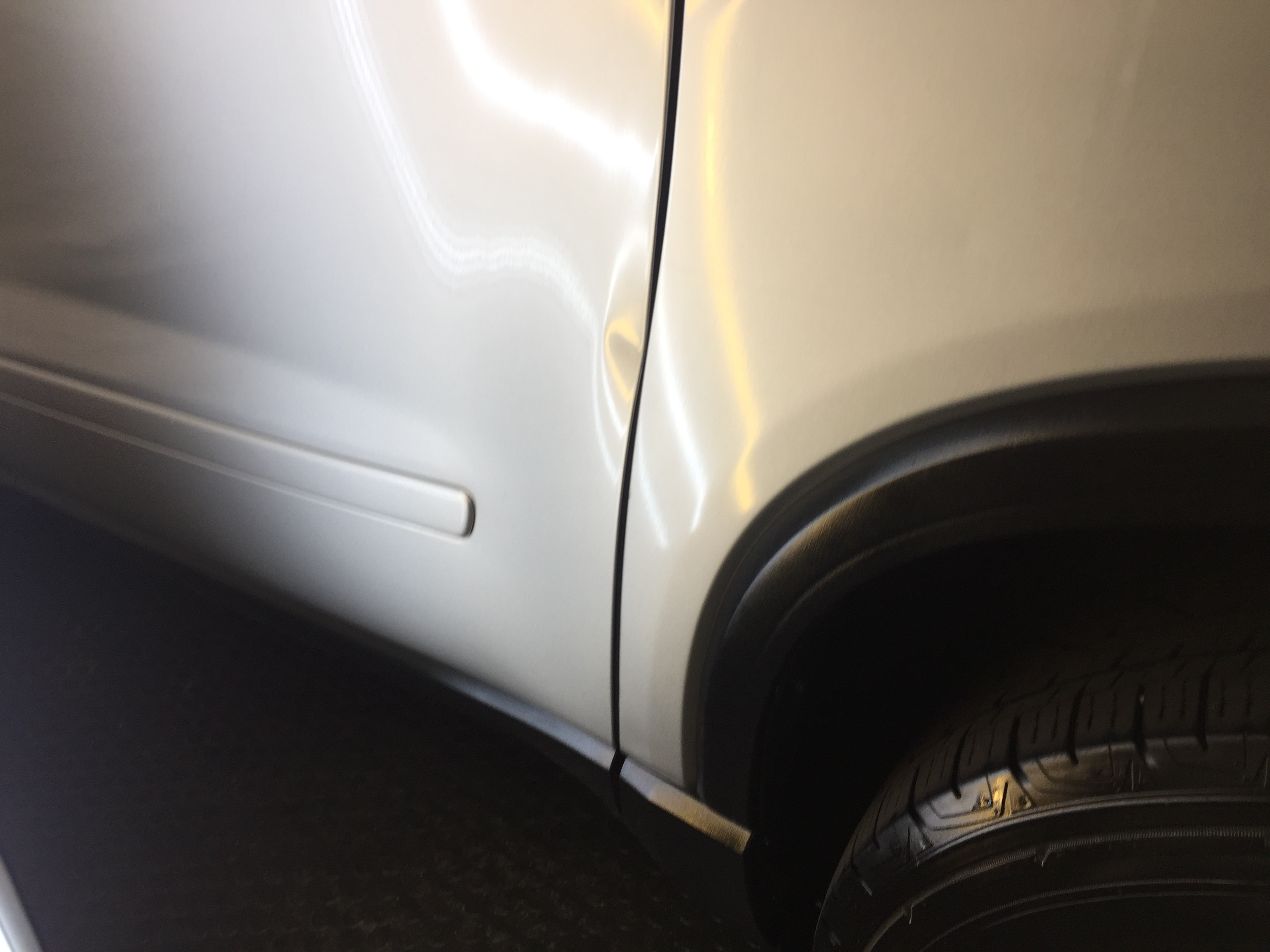 2012 GMC Acadia Dent Removal, Springfield, IL. Major damage in rear quarter, http://217dent.com