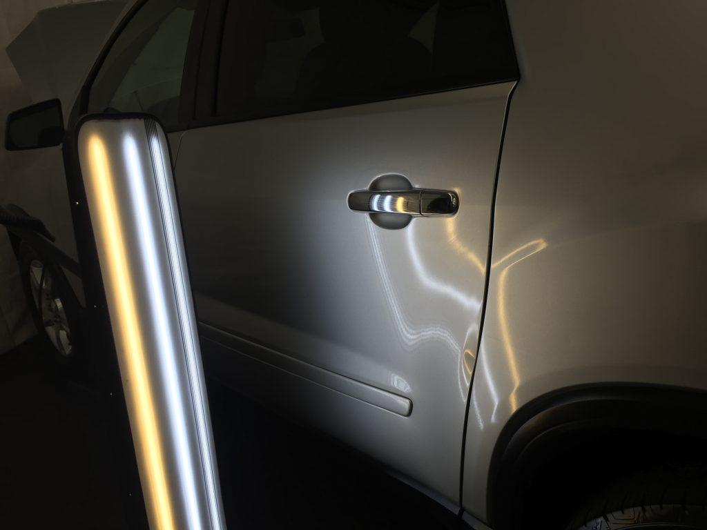 2012 GMC Acadia Dent Removal, Springfield, IL. Major damage in rear quarter, http://217dent.com