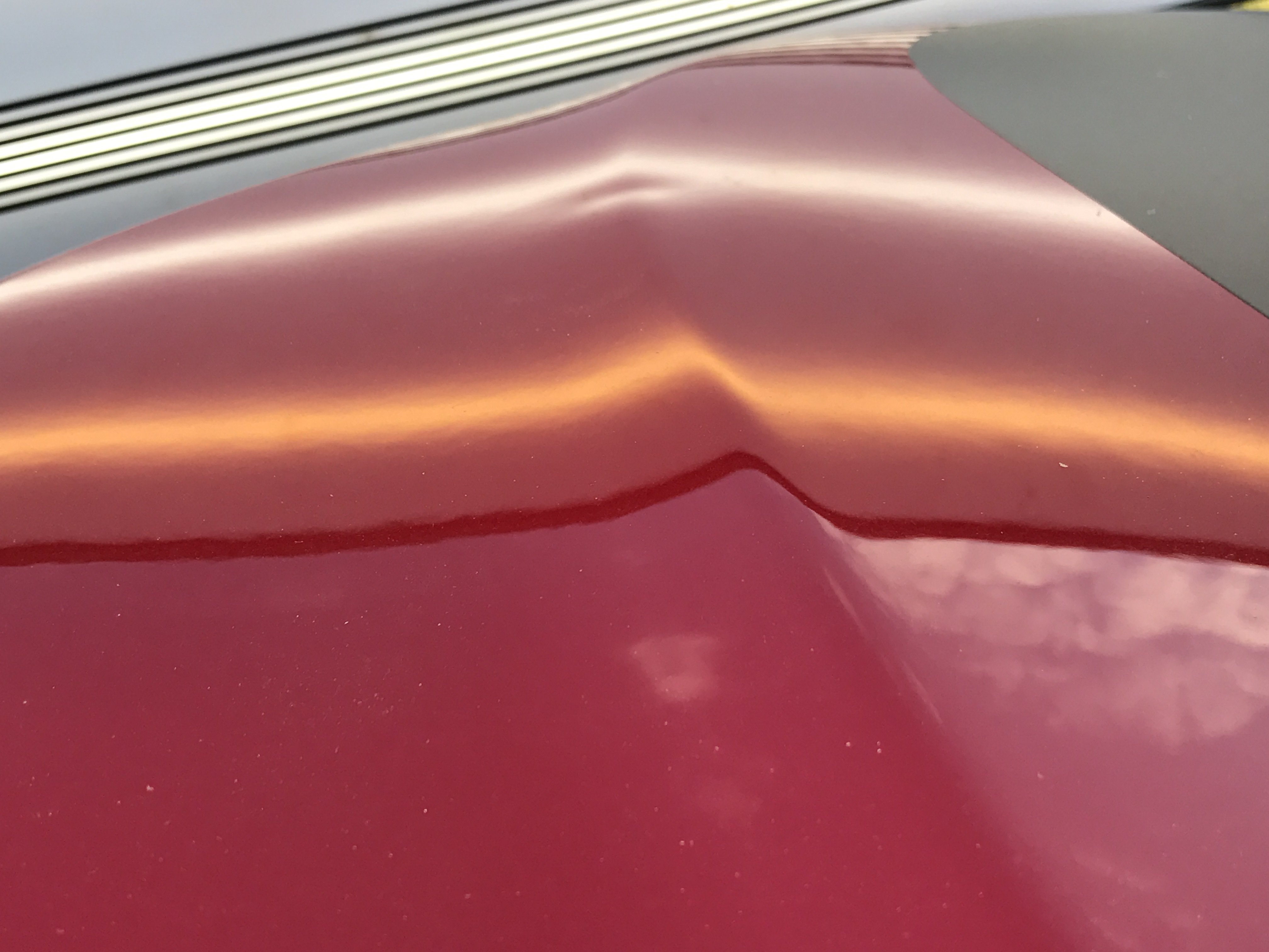 2017 Jeep Grand Cherokee Trailhawk New Vehicel dent removal, this is the before image. Michael was called in to remove this dent at a dealership, to maintain value and to maintain the vehicle's original paint.. http://217dent.com Serving Springfield, Decatur, Taylorville, and surrounding areas. (Before Image)