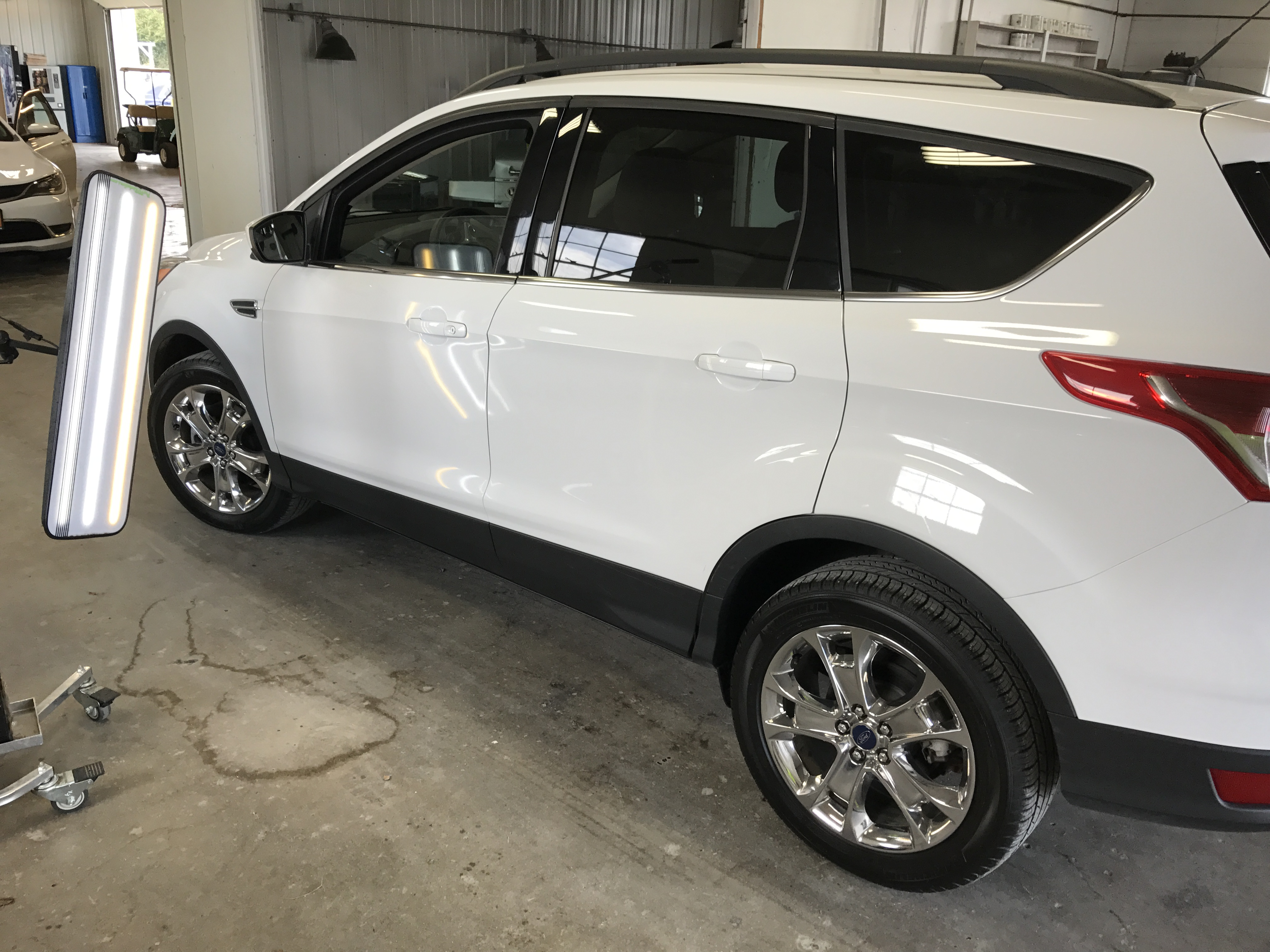2016 Ford Escape dent removal on the drivers door, in Pana IL, Springfield IL, we are all set up and ready to make these dents disappear.