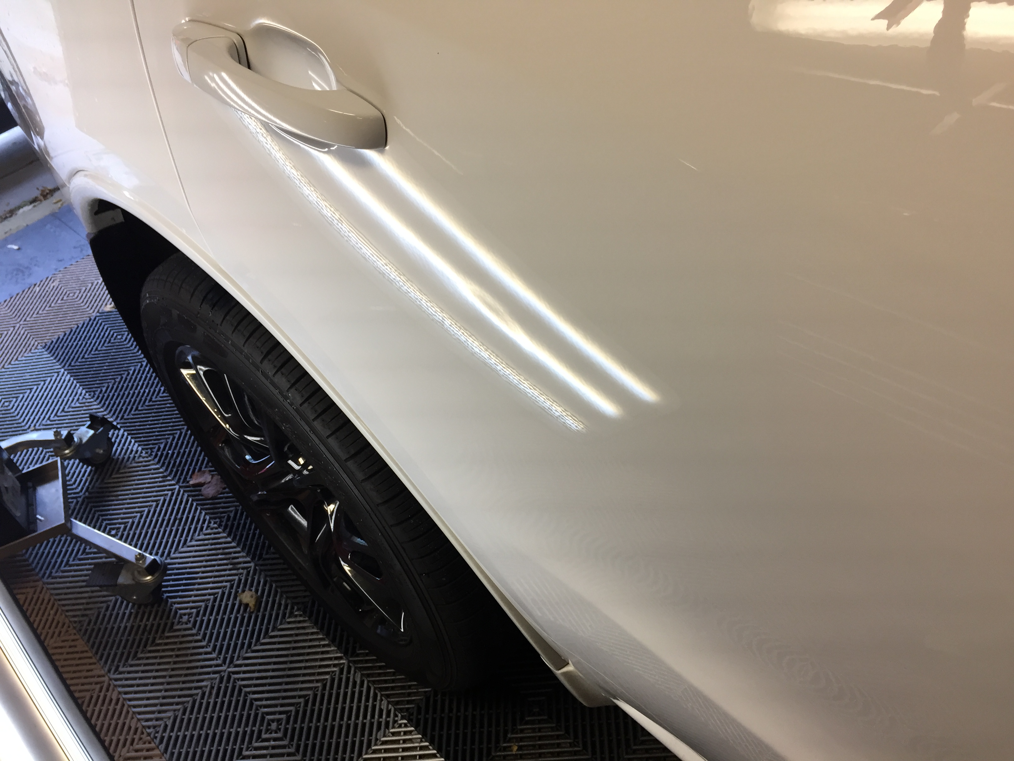 2015 Dodge Durango RT Paintless Dent Removal, Springfield IL http://217dent.com Before Image of door damage