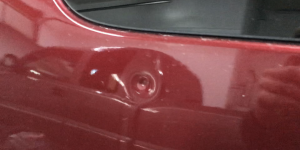 Springfield, IL Dent repair, http://217Dent.com Photo of a sharp dent in the rear quarter of a 2010 Yukon. (Before Image)