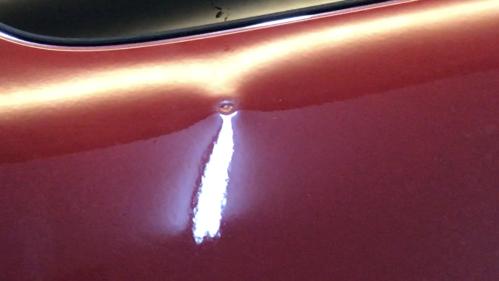 Springfield, IL Dent repair, http://217Dent.com  Photo of a sharp dent in the rear quarter of a 2010 Yukon. (During Image)