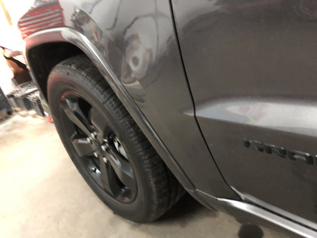 Large dent in the fender of this Grand Cherokee, Before the paintless dent removal process was performed by Michael Bocek out of Springfield, IL http://217Dent.com