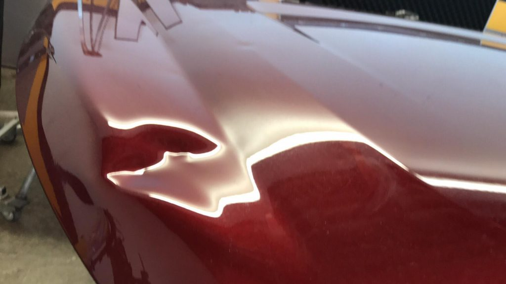 http://PuebloHailAndDent.com Large softball size dent on hood of this 2018 Acadia, one shop through it away and we picked it up to repair it and show off our work in our shop. Come and see this dent and watch a video of the repair process. http://PuebloHailAndDent.com Pueblo Colorado, 30 minutes south of Colorado Springs on 25